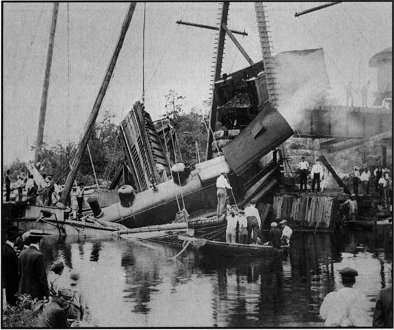"Delaware Railroad's Norfolk Express collides with a the schooner ""Golden Gate"" on June 20, 1904, in Laurel, Delaware, at open railroad drawbridge, photo courtesy of Mariners Museum, Newport News, VA."